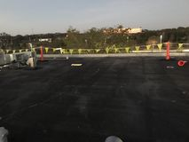 Field view of Modified Cap sheet Commercial flat roof with safety flags before tear off stock images