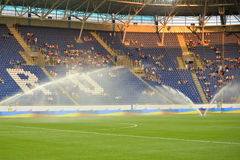 Field watered before the match Royalty Free Stock Photography