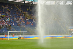 Field watered before the match Royalty Free Stock Images
