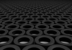 Field of wheels. Neat rows of tires stretching into the distance Stock Photos