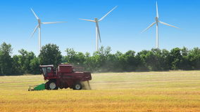 Field, wind power and harvester Royalty Free Stock Photo