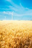 Field and wind turbine Stock Photos