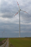 Field and wind turbines in a cloudy morning Royalty Free Stock Photography