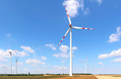 Field windmill farm. Windmill energy farm on large land field stock images