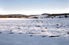 Field in winter. Empty field covered with snow Stock Photo