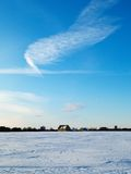 Field in winter. Covered by snow Stock Photography