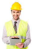 Field worker operating touch pad device Royalty Free Stock Photo