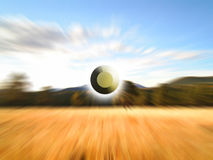 Field zoom. A circle craft zooming across a field royalty free stock image