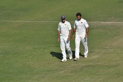 Fielder and Bowler Discussion in Cricket Stock Photo