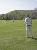 Fielding in the deep. English village cricket royalty free stock image