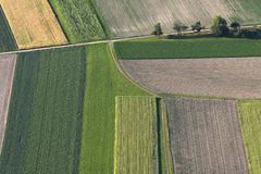 Fields from above. Multicolored nature pattern. Fields, road and trees stock photos