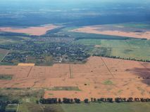 Fields around Kiev, photographed from height, alternation of green and brown squares, fertile land Ukraine. Stock Photography