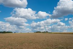 Fields around Tubbergen, the Netherlands,. After a dry summer with beautiful white clouds with a blue sky stock images