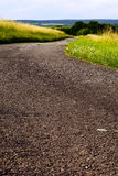 Fields asphalt road Royalty Free Stock Photos