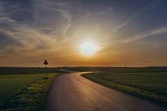 Fields in Austria. Sunset over road in Rabensburg village in Austria stock photo