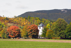 Fields and church in Liptovska Sielnica royalty free stock image