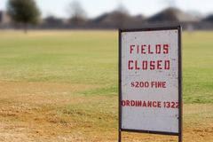 Fields closed. Sign posted stating that the playing fields are closed for the season Stock Photo