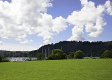 Fields and Clouds Lake Windermere. Tranquil scene at Lake Windermere Cumbria Stock Photo