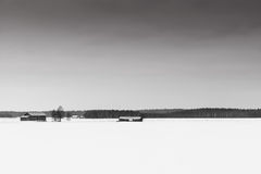 Fields Covered With Snow. The emptiness of the landscape is emphasized in this typical shot of the Finnish countryside royalty free stock photos