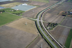 Fields, farms, railroad. Train and highway Stock Image