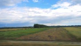 Through the fast running train window. Fields through the fast running train window stock video