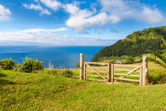 Fields and fence over Atlantic Ocean in Sao Miguel, Azores Royalty Free Stock Photos