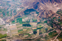 Fields on the foot of the mountain. Aerrial view of the fields on the foot of the mountain Royalty Free Stock Photos
