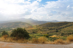 Fields of Greece near Mycenae. Beautiful valley with fields captured from a gravel road in Greece near Mycenae archaeological site Stock Photo