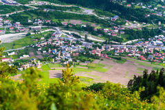 Fields and houses in Mestia, Georgia Royalty Free Stock Image