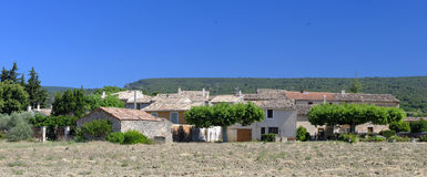 Fields and houses in Provence. France Royalty Free Stock Photo