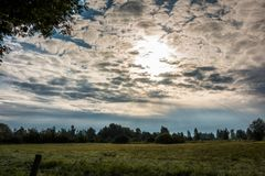 Fields and meadows. Green fields, meadows and forests with bright sky and clouds Royalty Free Stock Photo