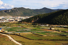 Fields and mountain. View from Songzanlin Monastery near Zhongdian, China, the largest Tibetan Buddhist monastery in Yunnan province Royalty Free Stock Image