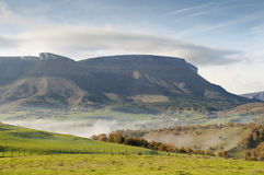 Fields and mountains on a cold morning, fog in the valley Stock Image