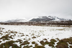 Fields and mountains covered by the snow. In winter Stock Photography
