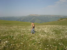 Fields in mountains summer flowers woman stralling Stock Photos