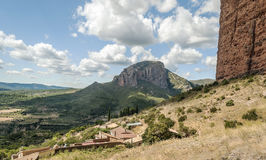 Fields of Riglos. View of the Fields of de Riglos, is a cloudy day. It is located in the Spanish province of Huesca along the Pyrenees. You can see some houses Royalty Free Stock Photos