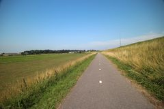 Fields, roads,bicycle lanes and canals along the of the Hollandsche IJssel in Moordrecht, the Netherlands. / stock photos