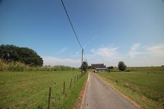 Fields, roads,bicycle lanes and canals along the of the Hollandsche IJssel in Moordrecht, the Netherlands. / stock images