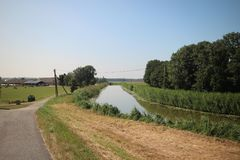 Fields, roads,bicycle lanes and canals along the of the Hollandsche IJssel in Moordrecht, the Netherlands. / stock photo