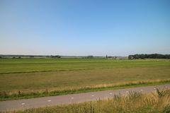 Fields, roads,bicycle lanes and canals along the of the Hollandsche IJssel in Moordrecht, the Netherlands. / stock image
