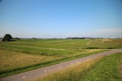 Fields, roads,bicycle lanes and canals along the of the Hollandsche IJssel in Moordrecht, the Netherlands. Fields, roads,bicycle lanes and canals along the of stock photos