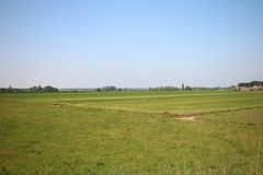 Fields, roads,bicycle lanes and canals along the of the Hollandsche IJssel in Moordrecht, the Netherlands. Fields, roads,bicycle lanes and canals along the of stock photography