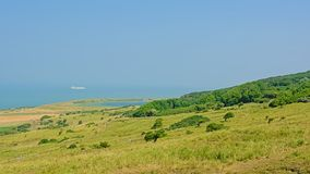 Fields with shrubs and lake along the French North sea coast,. Fields with shrubs and lake along the Opal North sea coast in France, on a sunny day stock photos