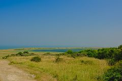 Fields with shrubs and lake along the French North sea coast,. Fields with shrubs and lake along the Opal North sea coast in France, on a sunny day royalty free stock photo
