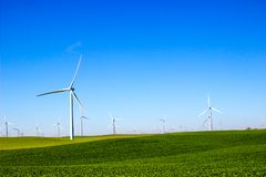 Fields With Three Bladed Energy Producing Windmills Stock Images