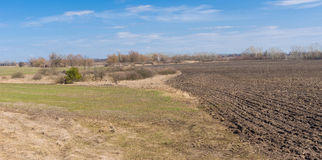 Fields in Ukraine in spring season. Agricultural fields in Ukraine at spring season Royalty Free Stock Images