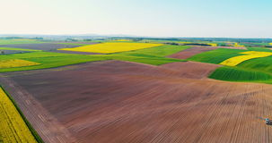 Fields with various types of agriculture 4K. Aerial view of fields with various types of agriculture 4K. GMO free food production stock footage