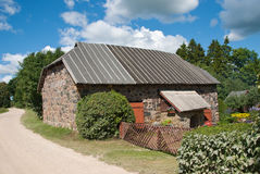 Fieldstone storehouse. Old granite storehouse in estonian countryside Royalty Free Stock Photography