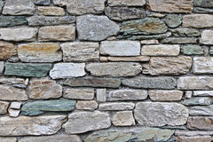 Fieldstone wall. With differently sized and coloured stones Royalty Free Stock Photography
