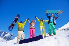 Fiends with snowboard in mountains Stock Photos